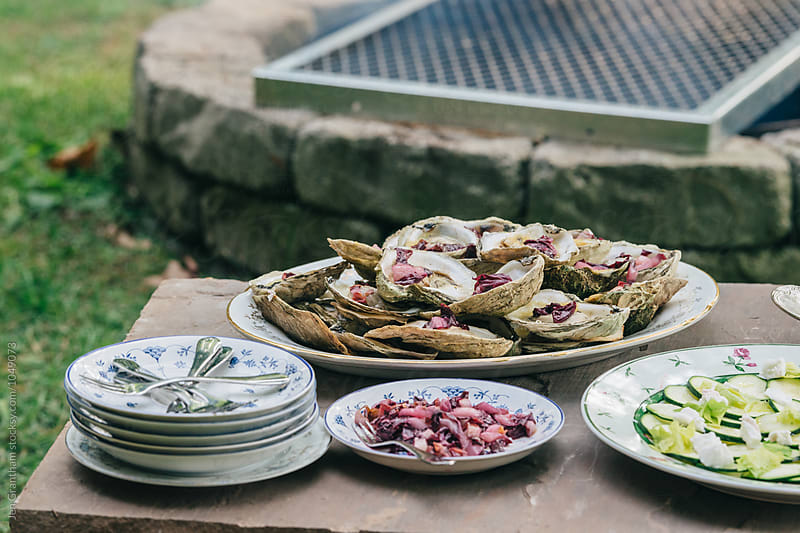 Campfire cooked oysters with miso butter and pickled treviso