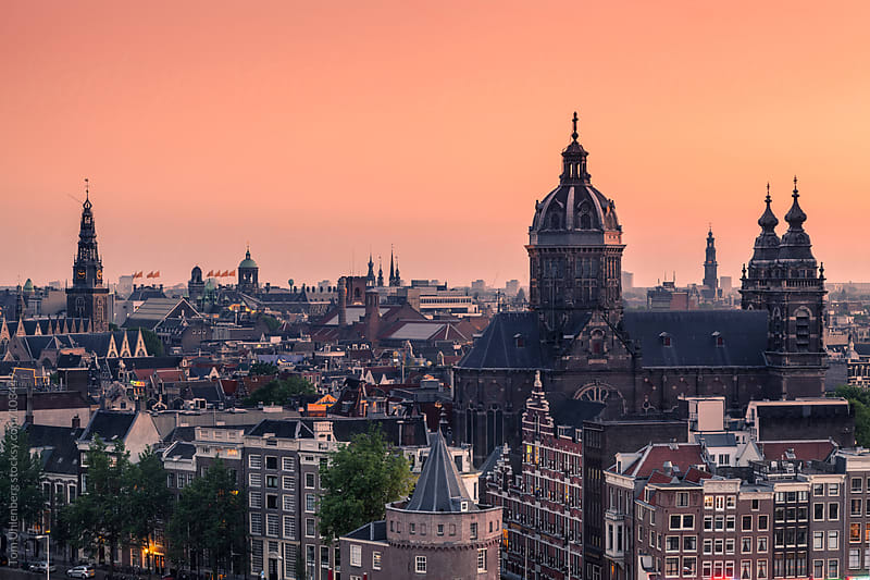 Amsterdam Skyline at Dusk, the Netherlands by Tom Uhlenberg for Stocksy United