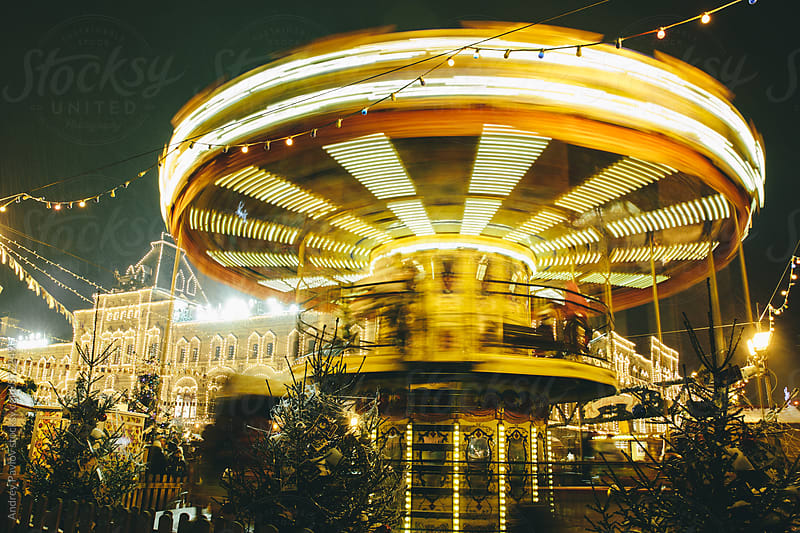 Illuminated bright fair carousel by Andrey Pavlov for Stocksy United