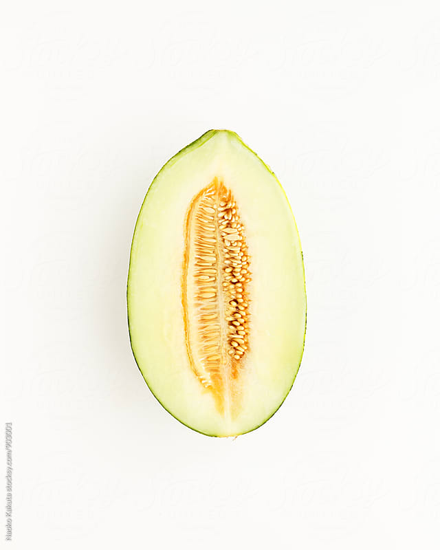 half of cantaloupe / piel de capo on white background by Naoko Kakuta for Stocksy United