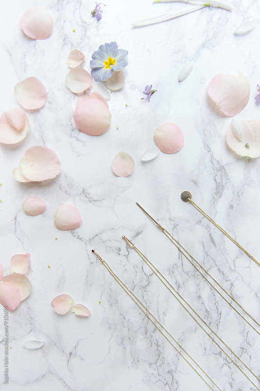 Flowers, marble and jewelry by Sophia Hsin for Stocksy United