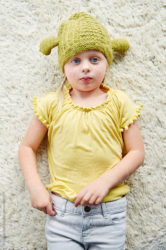 Portrait of cute little girl on floor  by Trinette Reed for Stocksy United