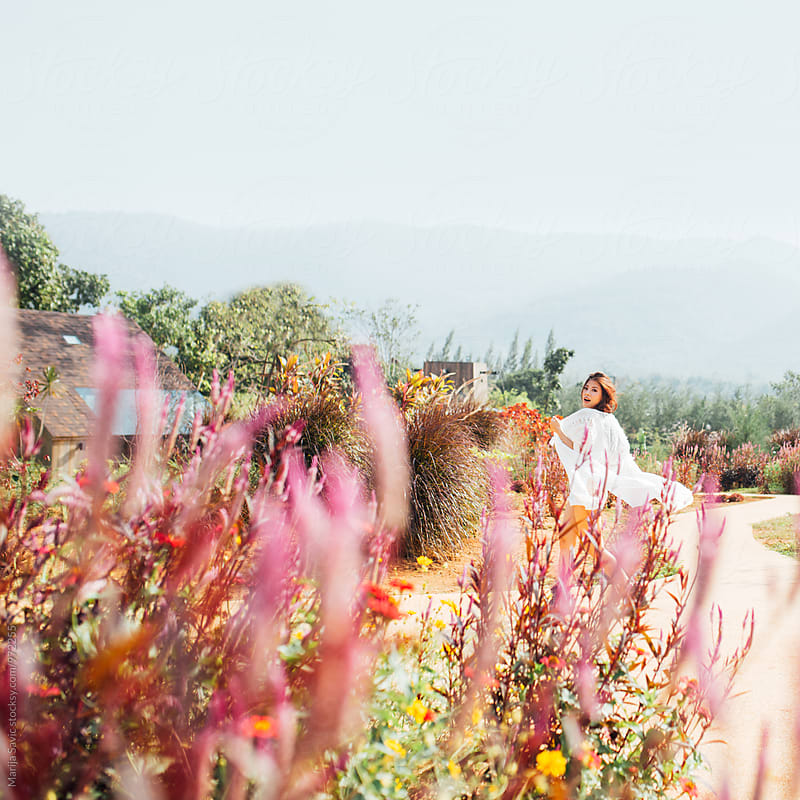Happy Woman in the Mountain by Marija Savic for Stocksy United