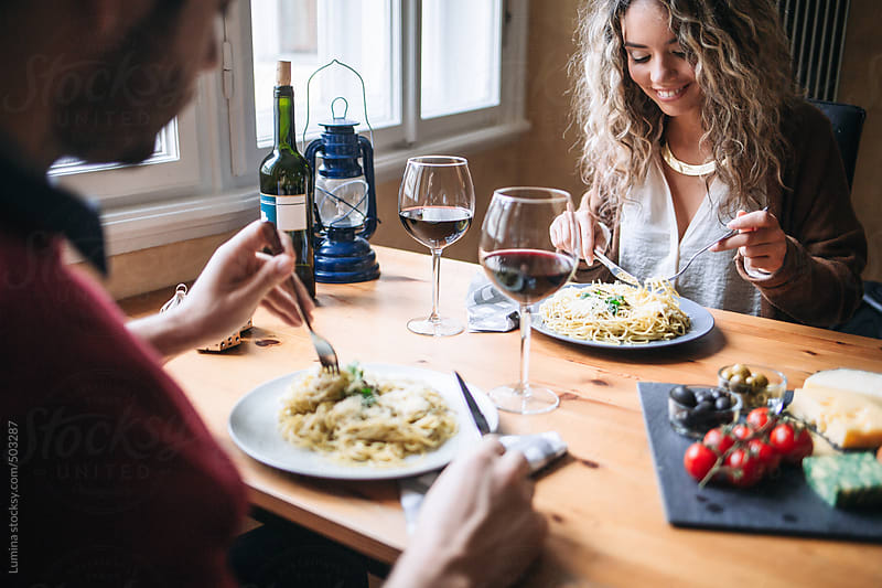 Caucasian Couple Eating Spaghetti With Red Wine by Lumina for Stocksy United