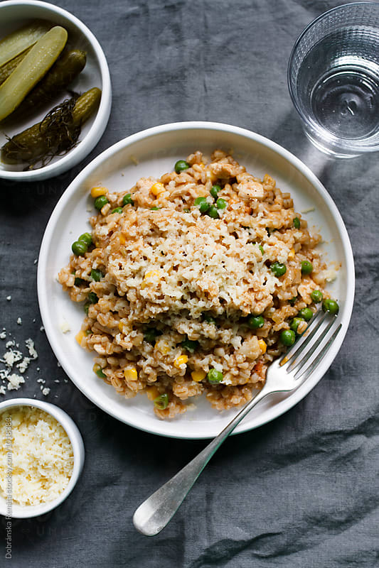 Pearl barley risotto with vegetables and cheese by Dobránska Renáta for Stocksy United