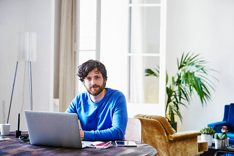 Handsome Man With Laptop On Table At Home by ALTO IMAGES for Stocksy United
