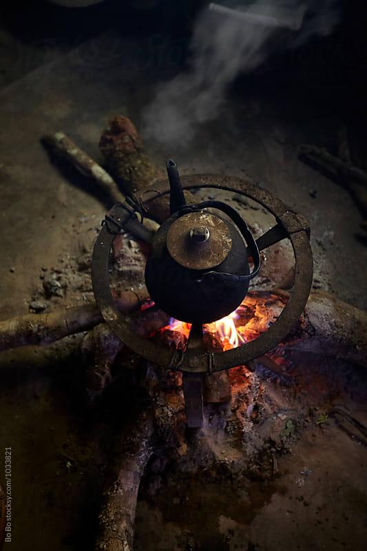 tea pot on campfire by Bo Bo for Stocksy United