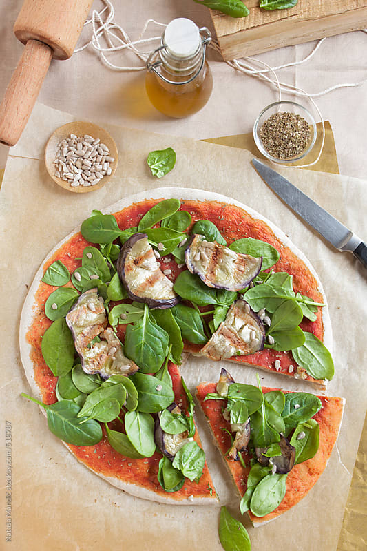 Pizza with spinach and aubergine by Nataša Mandić for Stocksy United
