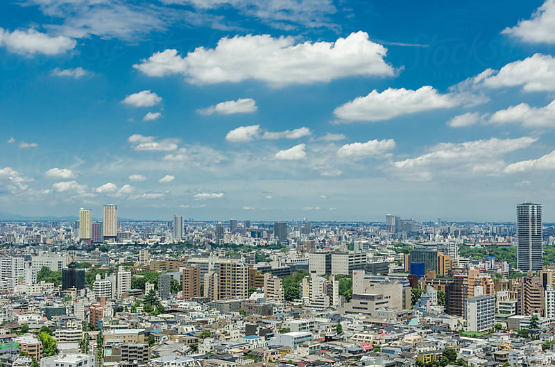 Tokyo With Puffy Clouds And A Blue Sky by Leslie Taylor for Stocksy United