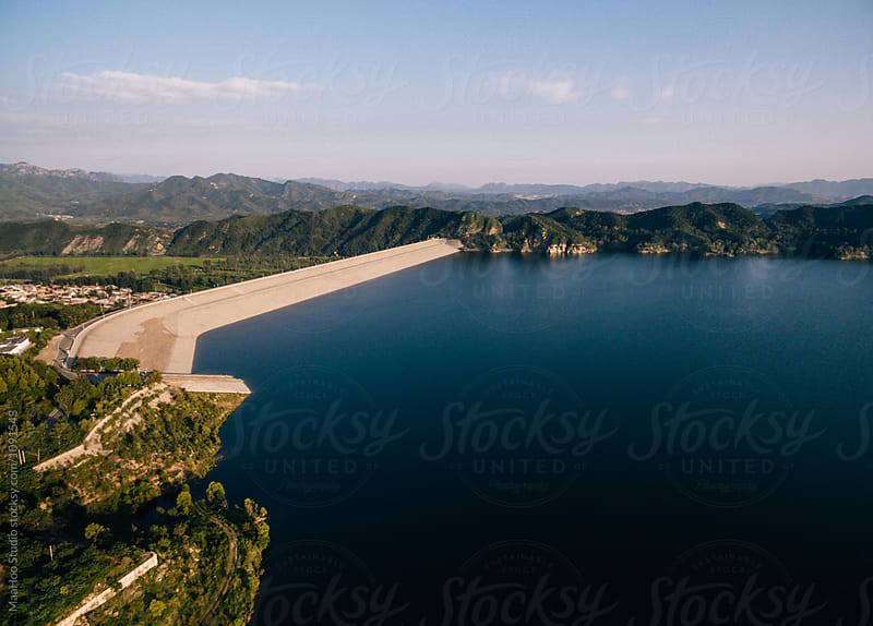 Aerial  view of reservoir dike by Maa Hoo for Stocksy United