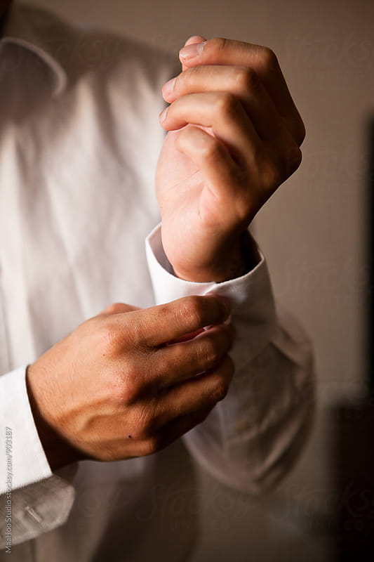Man clipping cufflinks by MaaHoo Studio for Stocksy United