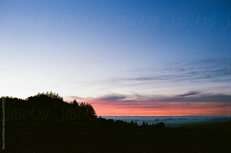 Sunset over Big Sur mountains by Reece McMillan for Stocksy United