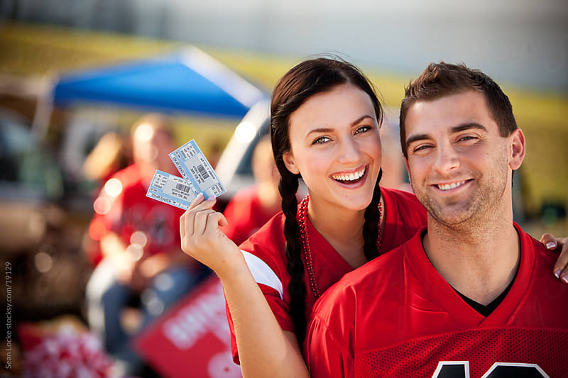 Tailgating: Cute Couple Ready to Attend Game by Sean Locke for Stocksy United