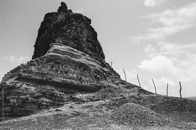 Interesting rock formation and land mass in black and white by Lawrence del Mundo for Stocksy United