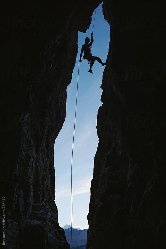 Male alpinist abseiling from the top of a cave by RG&B Images for Stocksy United
