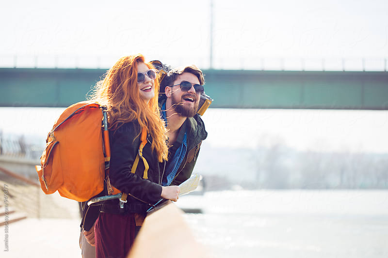 Happy Couple Travelling With a Backpack by Lumina for Stocksy United