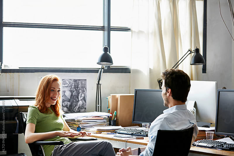 Business People Having Discussion In Startup Office by ALTO IMAGES for Stocksy United