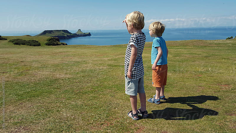 Two little boys looking at the view together by sally anscombe for Stocksy United
