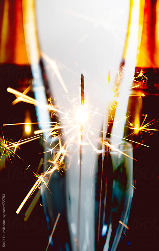 fireworks and champagne by Sonja Lekovic for Stocksy United