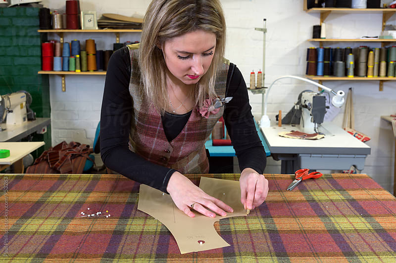 Marking out tartan material for a  waistcoat.  by Paul Phillips for Stocksy United