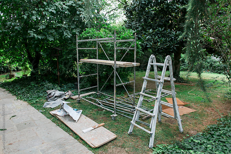 Painter equipment in garden by Laura Stolfi for Stocksy United