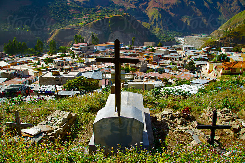 Three graves with crosses on a hillside cemetery in the mountain community of Saint Teresa, Peru  by Jaydene Chapman for Stocksy United