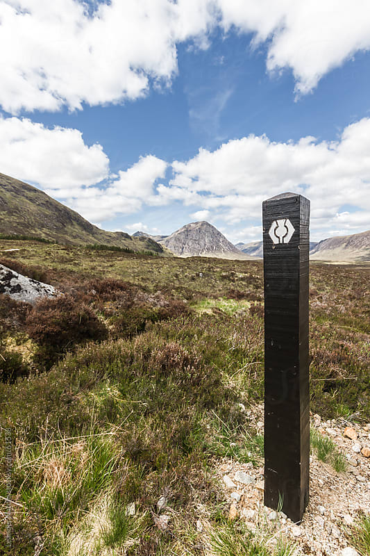 waymark of the west highland way in the scottish highlands by Leander Nardin for Stocksy United