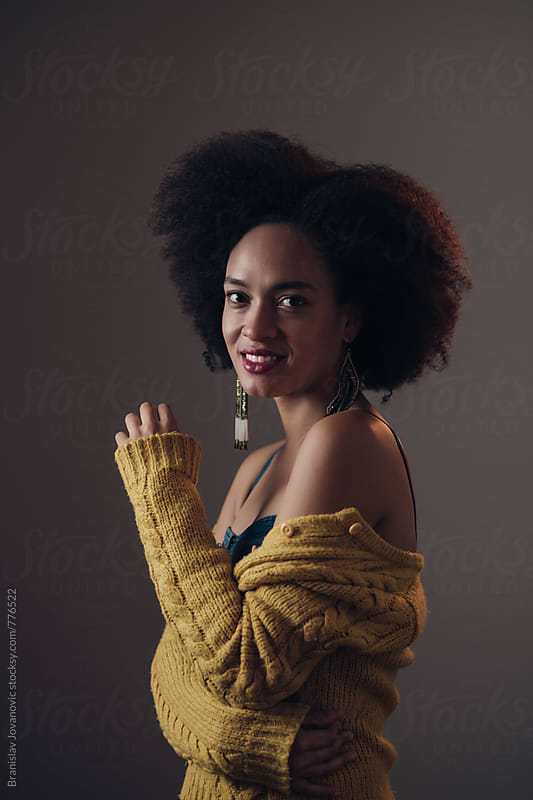 Studio Portrait of a Beautiful Young Woman with Afro Hairstyle by Branislav Jovanović for Stocksy United
