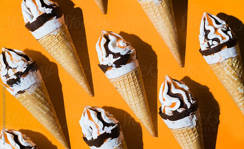 Caramel vanilla and chocolate ice creams on orange background. by Audrey Shtecinjo for Stocksy United