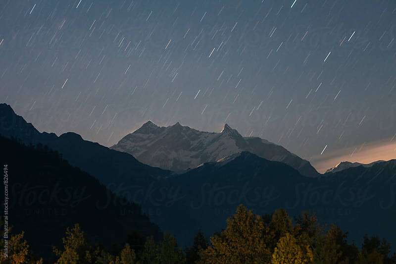 Annapurna range on a starry night. by Shikhar Bhattarai for Stocksy United