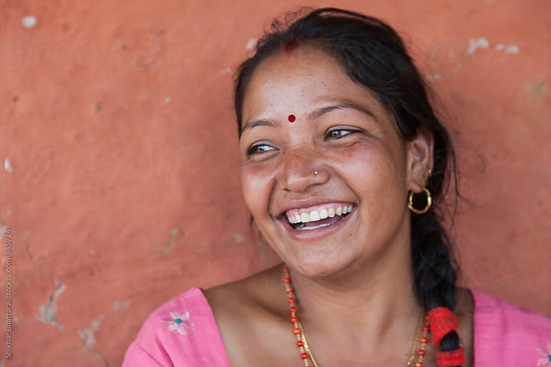 Young Nepali woman with a beautiful smile. by Shikhar Bhattarai for Stocksy United