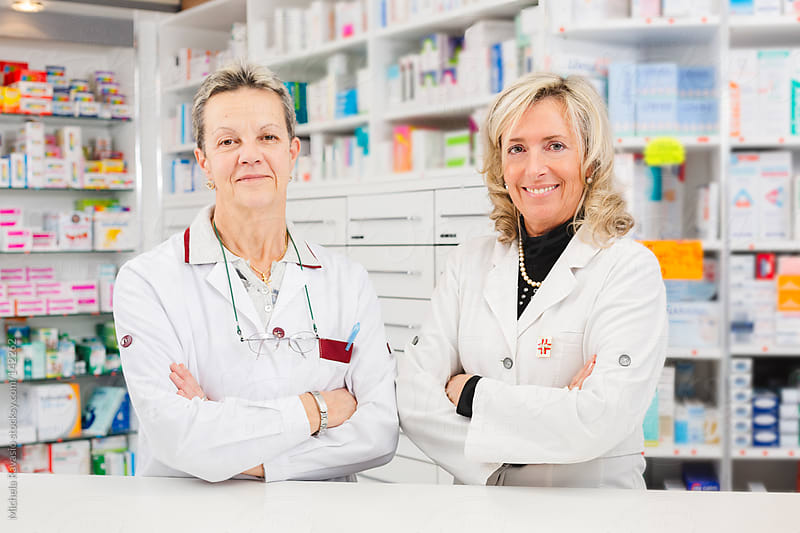 Doctors pharmacists at work by michela ravasio for Stocksy United