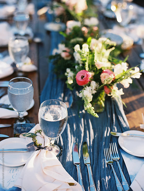 tablescape with blue and pink flowers by wendy laurel for Stocksy United