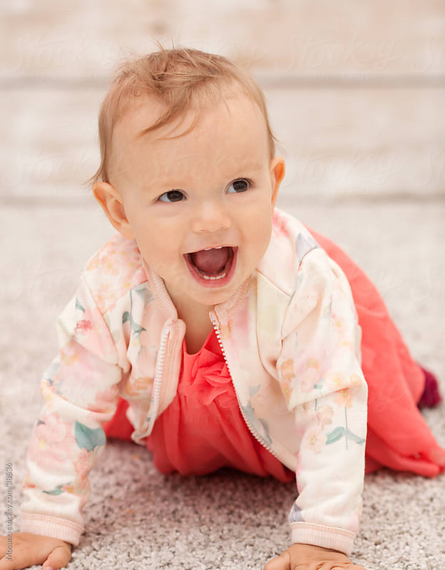 Cute little baby girl crawling. by Mosuno for Stocksy United
