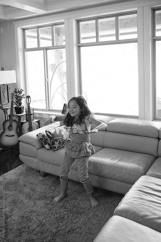 Little Girl Dancing In Living Room by Ronnie Comeau for Stocksy United