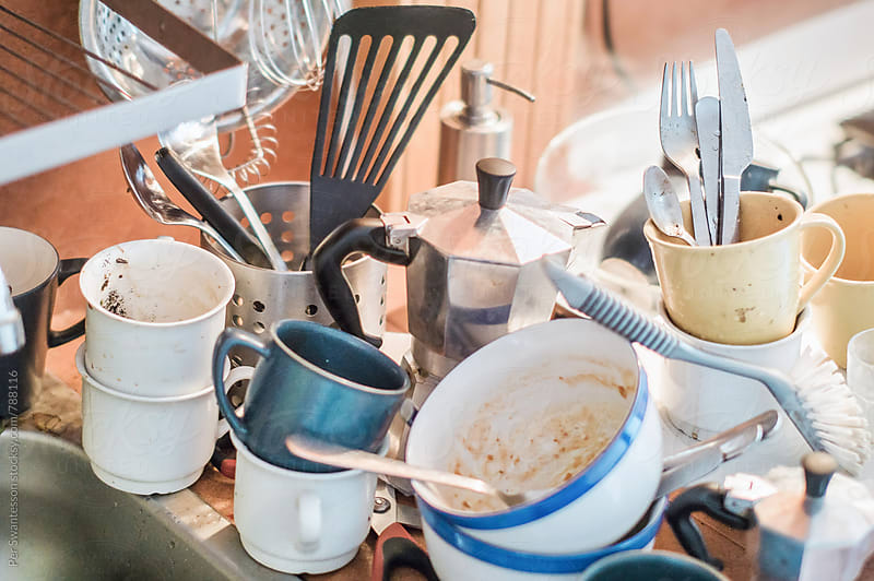 Dirty dishes in a kitchen by Per Swantesson for Stocksy United