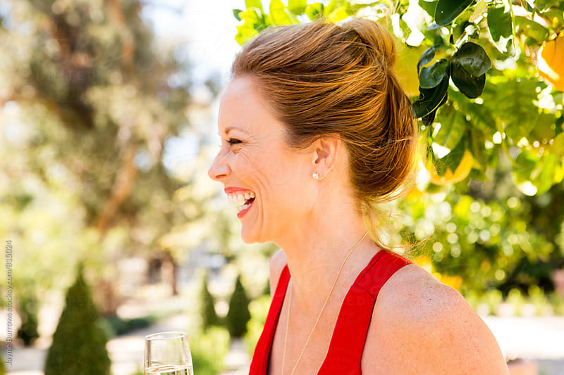 Woman in a Citrus Grove by Jayme Burrows for Stocksy United