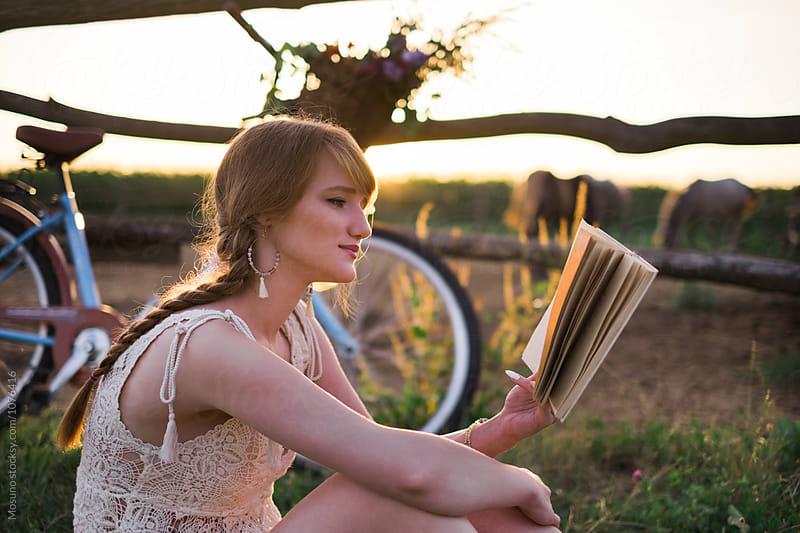 Beautiful Woman Reading a Book in Nature by Mosuno for Stocksy United