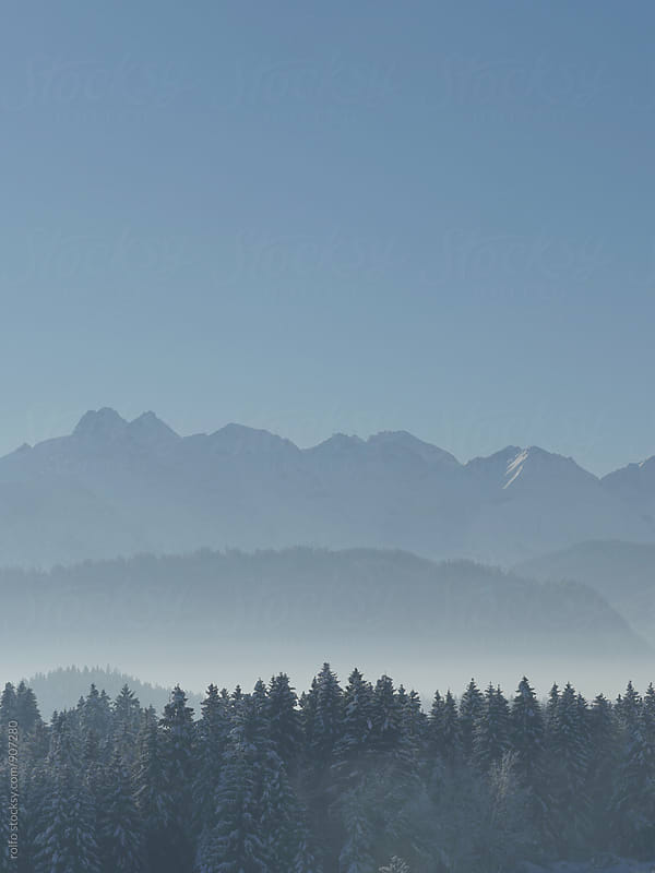 Beautiful silhouette of mountains in snow by rolfo for Stocksy United
