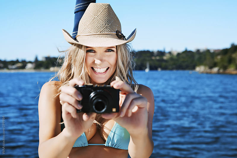 Smiling Female With Camera by WAA for Stocksy United