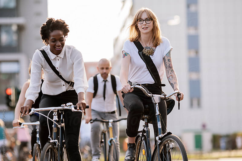 Three Office workers Commuting on Bicycles by VegterFoto for Stocksy United