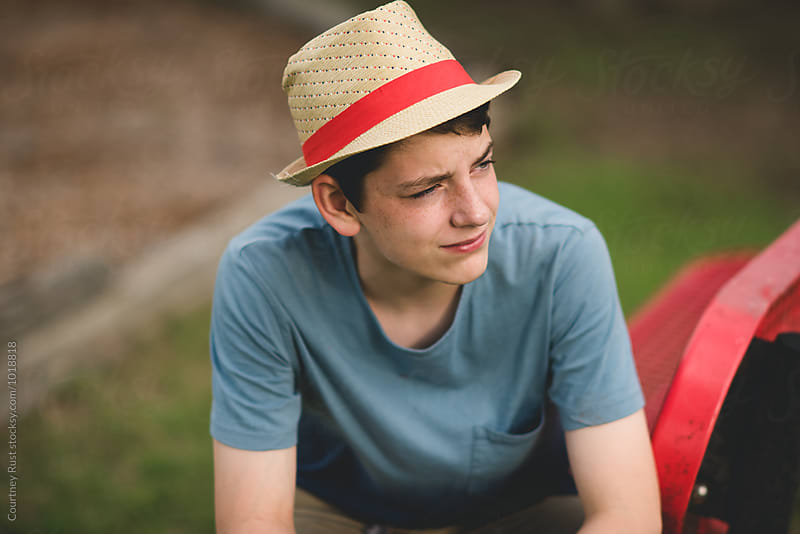 Portrait of a young man in a hat by Courtney Rust for Stocksy United