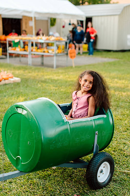 Little Girl Riding a Car / HayRide Outdoor by Kristen Curette Hines for Stocksy United