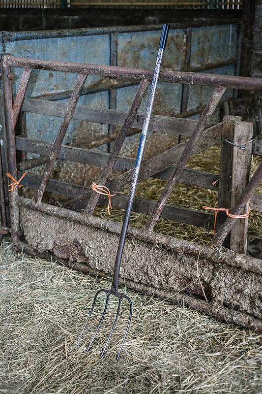 Pitchfork in a barn. by Darren Muir for Stocksy United
