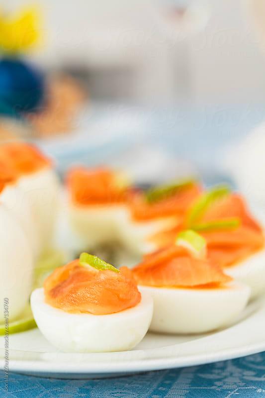 Eggs with salmon by Borislav Zhuykov for Stocksy United
