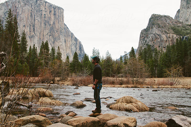 Man in front of river by Jesse Morrow for Stocksy United