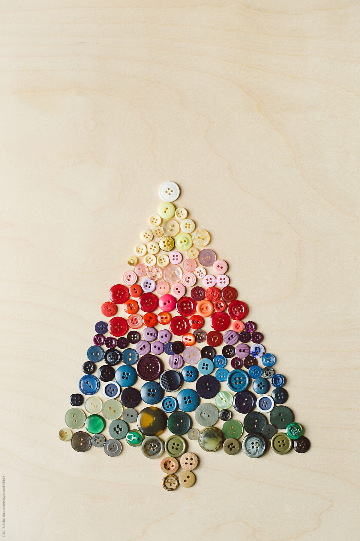 Christmas tree made with buttons by CACTUS Creative Studio for Stocksy United