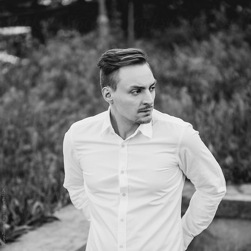 Portrait of a young man by Tatjana Zlatkovic for Stocksy United
