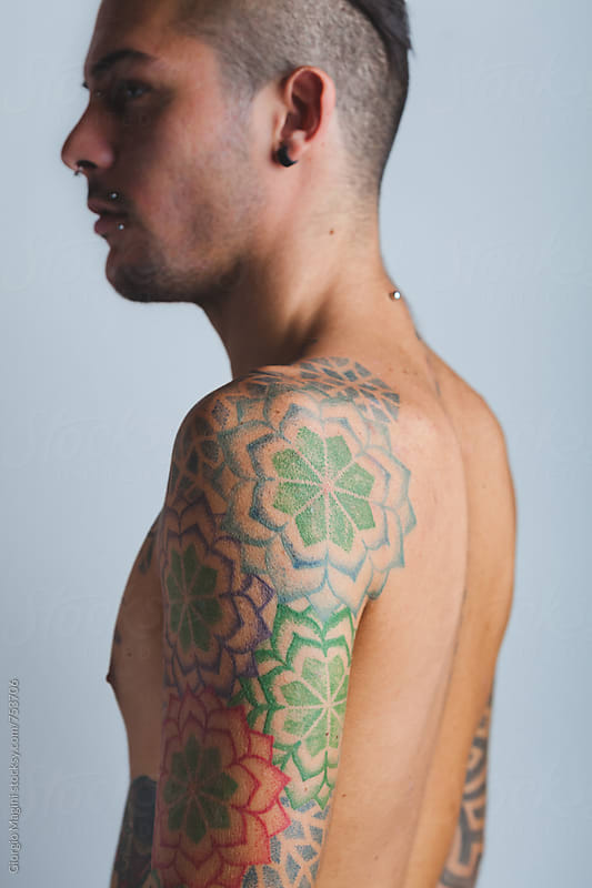 Young Man with Tattoos Flowers on the Shoulder by Giorgio Magini for Stocksy United