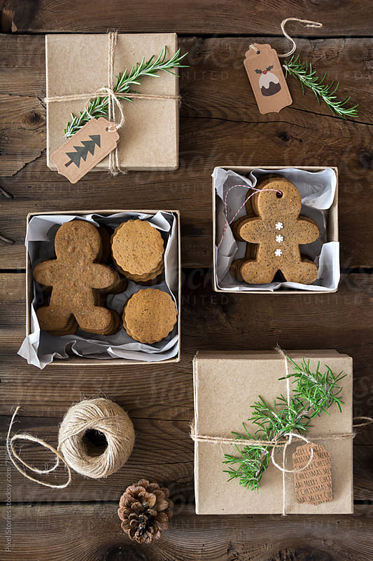 Gift-wrapped Gingerbread men cookies by Pixel Stories for Stocksy United
